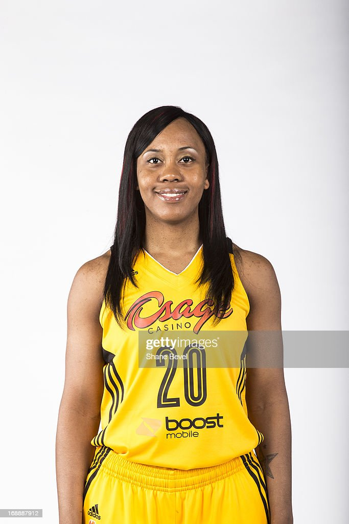 Amber Holt #20 of the Tulsa Shock poses for a picture during the team media day photo shoot on May 15, 2013 at the BOK Center in Tulsa, Oklahoma.