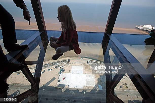 Amber Houghton, aged eight, tries out the new glass Skywalk at the top of the refurbished Blackpool Tower on September 1, 2011 in Blackpool, England....