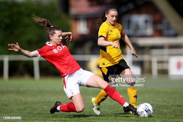 Amber Hughes of Wolverhampton Wanderers is challenged by Lyndsey Harkin of Nottingham Forest Women during the FAWNL Northern Premier Division match...