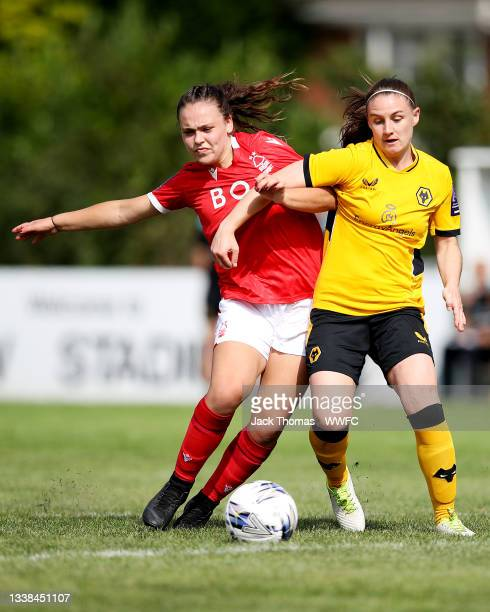 Amber Hughes of Wolverhampton Wanderers is challenged by Olivia Cook of Nottingham Forest Women during the FAWNL Northern Premier Division match...