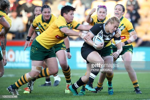 TOPSHOT Amber Kani of the New Zealand is tackled during the women's Trans Tasman rugby league international between New Zealand and Australia at Mt...
