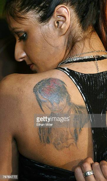 Amber Khan of Canada a fan of illusionist Criss Angel shows her tattoo of Angel during a ceremony awarding him the 2008 Merlin Award from the...