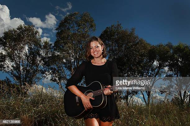 Amber Lawrence named Australian Country Music Female Artist of The Year poses at the Tamworth Entertainment Centre following her opening show with...