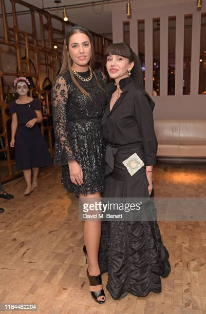 Amber Le Bon and Martha Ortiz attend Ella Canta's Day of the Dead celebration on October 30 2019 in London England