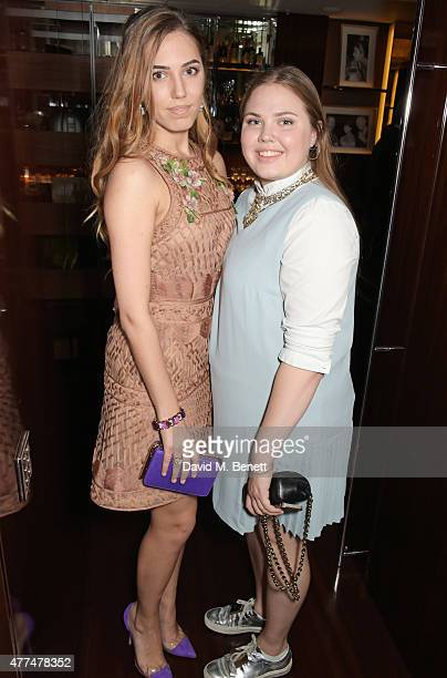 Amber Le Bon and Tallulah Le Bon attend the Red Magazine dinner in honour of Yasmin Le Bon at Bulgari Hotel on June 17 2015 in London England