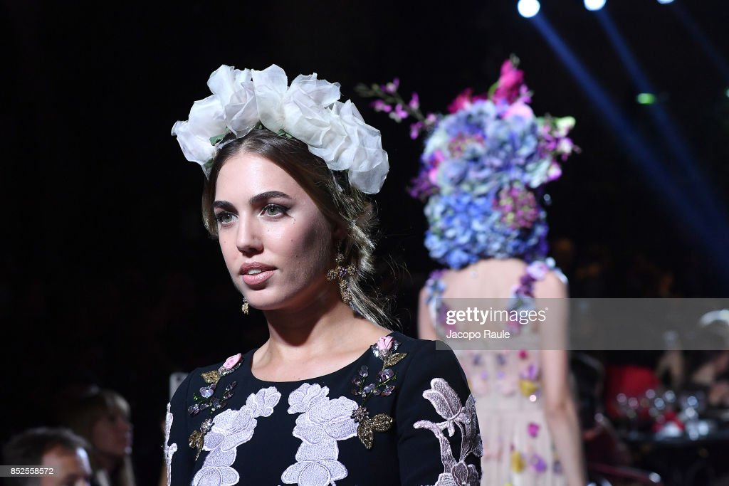 Amber Le Bon walks the runway at the Dolce & Gabbana secret show during Milan Fashion Week Spring/Summer 2018 at Bar Martini on September 23, 2017 in Milan, Italy.