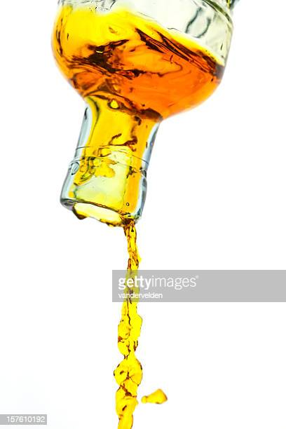 Amber Liquid Pouring Out Of A Bottle