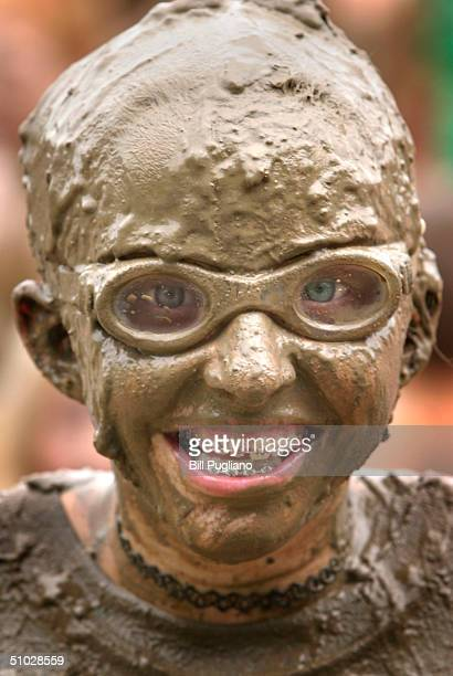 Amber Mueller of Brownstown MIchigan smiles while playing in the mud during the annual Mud Day event July 6 2004 in Westland Michigan The popular...