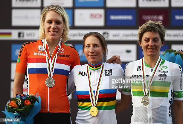 Amber Neben of USA celebrates winning the gold medal with silver medalist Ellen Van Dijk of the Netherlands and bronze medalist Katrin Garfoot of...