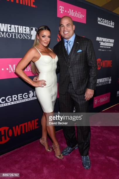 Amber Nichole Miller and MMA fighter Tito Ortiz arrive on TMobile's magenta carpet duirng the Showtime WME IME and Mayweather Promotions VIP PreFight...