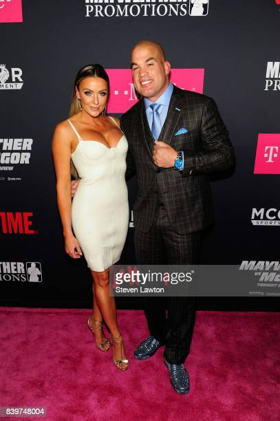 Amber Nichole Miller and MMA fighter Tito Ortiz attend the VIP party before the boxing match between boxer Floyd Mayweather Jr and Conor McGregor at...