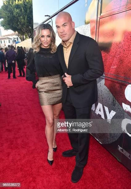 Amber Nicole Miller and Tito Ortiz attend the premiere of Columbia Pictures' 'Sicario Day Of The Soldado' at Regency Village Theatre on June 26 2018...