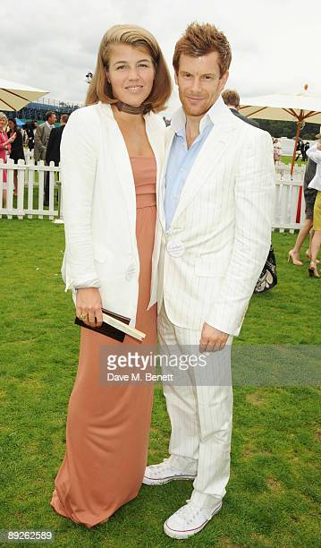 Amber Nuttall and Tom Aikens attend the annual Cartier International Polo Day at the Cartier Marquee in Great Windsor Park at Guards Polo Club on...
