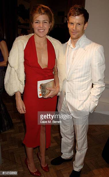Amber Nuttall and Tom Aikens attend the private view of Royal Academy of the Arts 'Summer Exhibition' at the Royal Academy of the Arts on June 4 2008...