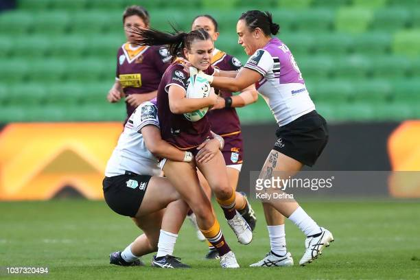 Amber Pilley of the Broncos is tackled by Warriors defence during the round three NRLW match between the Brisbane Broncos and the New Zealand...