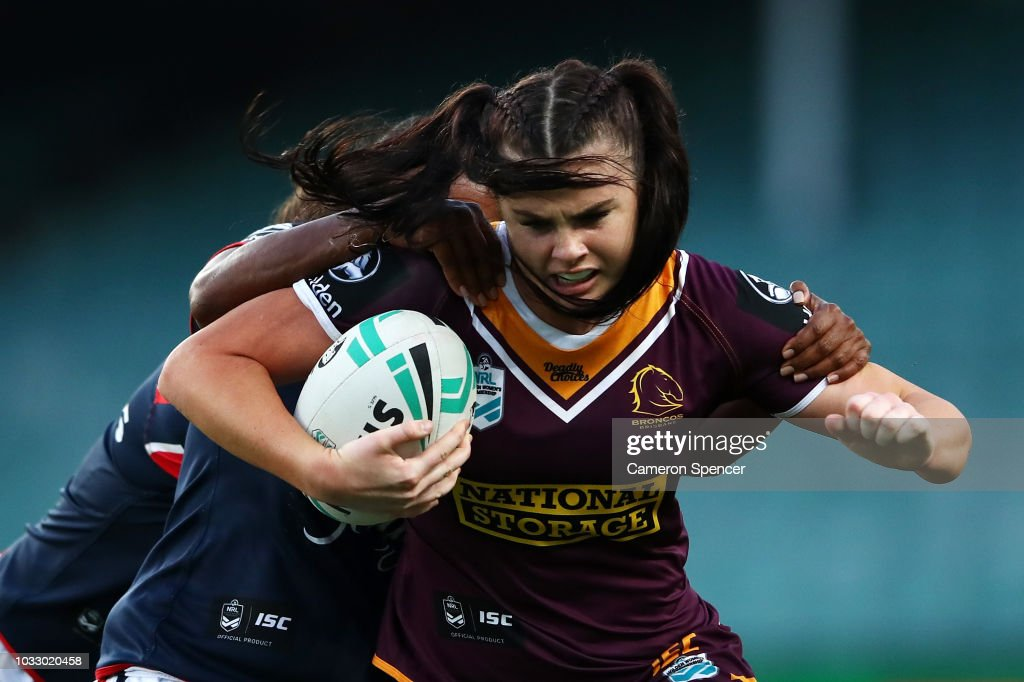 Amber Pilley of the Broncos is tackled during the round two Women's NRL match between the Sydney Roosters and the Brisbane Broncos at Allianz Stadium on September 14, 2018 in Sydney, Australia.