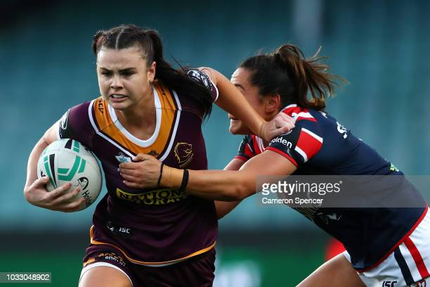 Amber Pilley of the Broncos is tackled during the round two Women's NRL match between the Sydney Roosters and the Brisbane Broncos at Allianz Stadium...