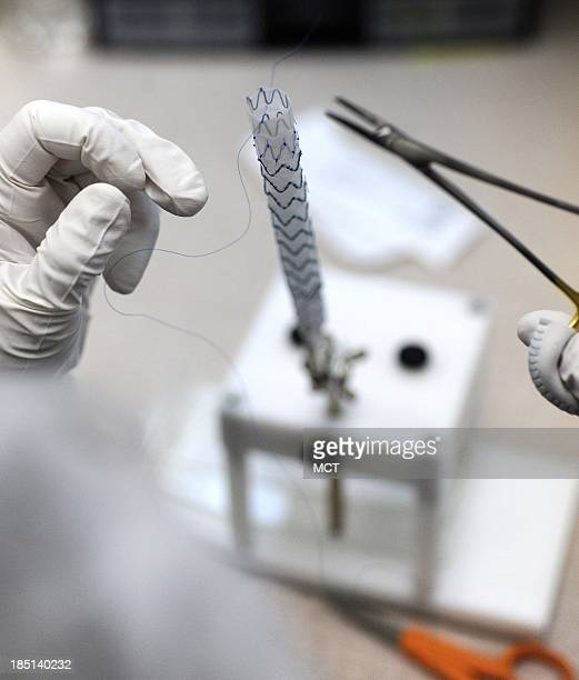 Amber Porter attaches a stent body to the graft material of a Zenith AAA flex stent at Cook Medical in Bloomington Indiana September 20 2011 With the...