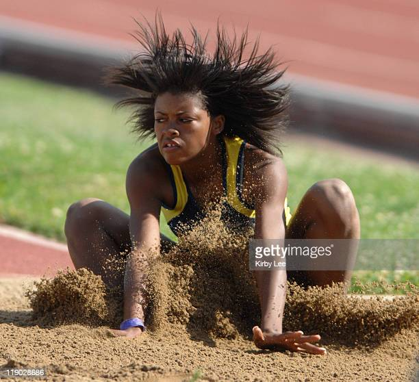 Amber Purvis of Benicia lands in the sand pit during the girls' long jump in the CIF State Track Field Championships at Hughes Stadium in Sacramento...