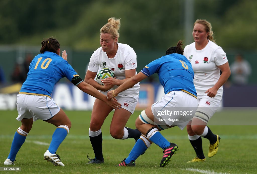 Amber Reed of England is tackled by Alice Trevisan (L) and Melissa Bettoni (R) of Italy during the Women's Rugby World Cup 2017 between England and Italy on August 13, 2017 in Dublin, Ireland.