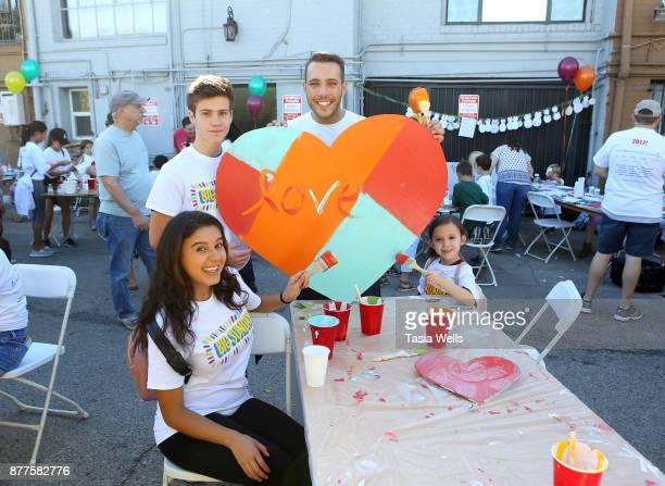 Amber Romero Lofton Shaw Lucas Lockwood and Drew Gordon at Big Sunday's 6th Annual BIG Thanksgiving Stuffing Event at Big Sunday Headquarters on...