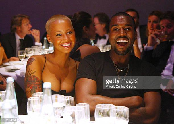 Amber Rose and Kanye West attend amfAR Milano 2009 Dinner the Inaugural Milan Fashion Week event at La Permanente on September 28 2009 in Milan Italy