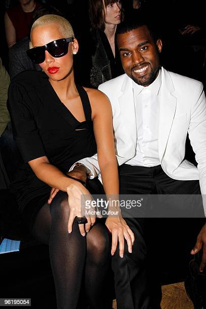 Amber Rose and Kanye West attend Givenchy Fashion Show during Paris Fashion Week Haute Couture S/S 2010 on January 26 2010 in Paris France