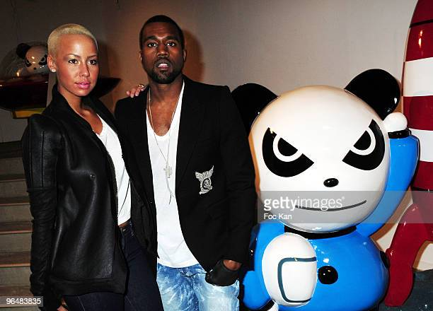 Amber Rose and Kanye West attend the Hi Panda Jiji's Sculptures Preview Cocktail Hosted by Antoine Arnault at the Palais De Tokyo on January 26 2010...