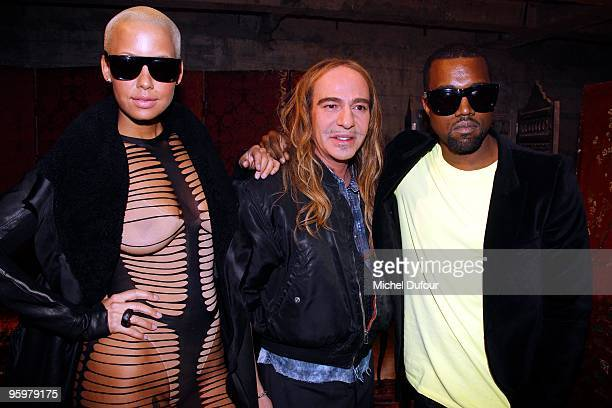 Amber Rose and Kanye West attend the John Galliano fashion show during Paris Menswear Fashion Week Autumn/Winter 2010 on January 22, 2010 in Paris,...