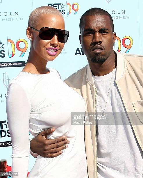 Amber Rose and rapper Kanye West arrive at the 2009 BET Awards at the Shrine Auditorium on June 28 2009 in Los Angeles California