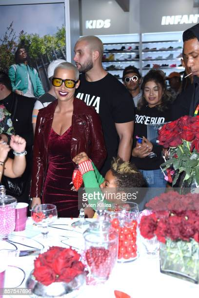 Amber Rose and Sebastian Taylor Thomaz attend Reebok Classic x Amber Rose Launch Event at Shoe Palace on September 30 2017 in Los Angeles California