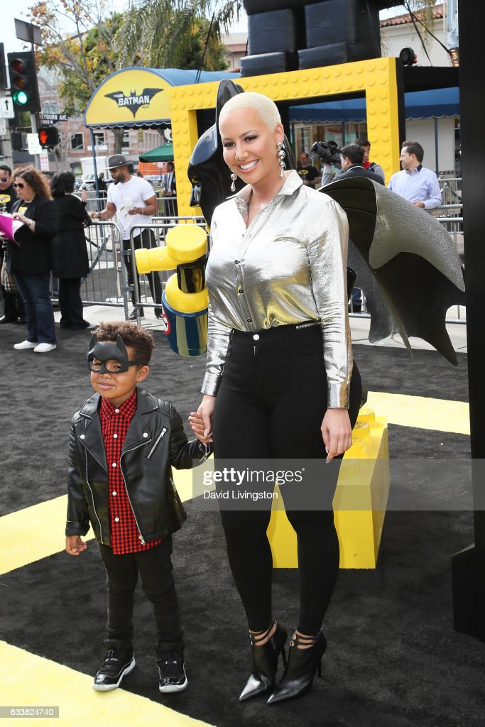 Amber Rose (R) and Sebastian Taylor Thomaz attend the Premiere of Warner Bros. Pictures' 'The LEGO Batman Movie' at the Regency Village Theatre on February 4, 2017 in Westwood, California.