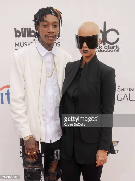 Amber Rose and Wiz Khalifa arrive at the 2014 Billboard Music Awards at the MGM Grand Garden Arena on May 18 2014 in Las Vegas Nevada