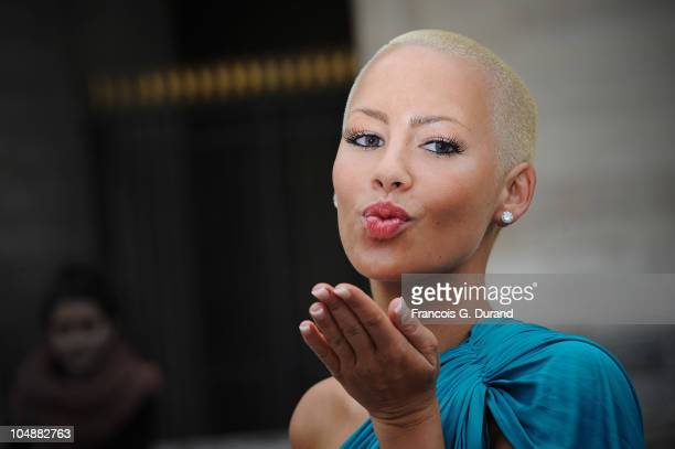 Amber Rose arrives for the Louis Vuitton Ready to Wear Spring/Summer 2011 show during Paris Fashion Week at Cour Carree du Louvre on October 6, 2010...