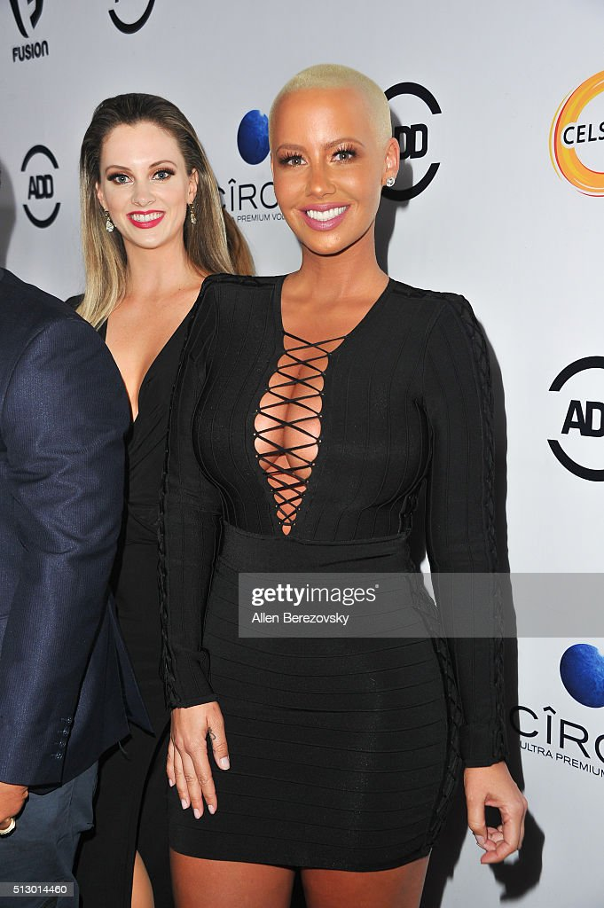 Amber Rose is photobombed by Nicole Arbour during the All Def Movie Awards at Lure Nightclub on February 24, 2016 in Los Angeles, California.