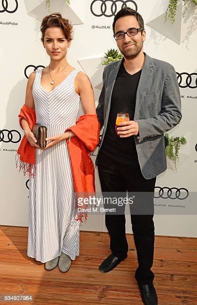 Amber Rose Revah and guest attend day one of the Audi Polo Challenge at Coworth Park on May 28 2016 in London England