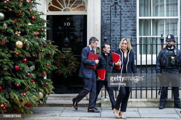 Amber Rudd UK work and pensions secretary second right Gavin Williamson UK defence secretary left and Alun Cairns UK Welsh secretary second left...