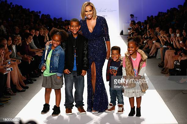 Amber Sabathia walks the runway with her children Carsten Jaden Cyia and Carter at Strut The Fashionable Mom Show during MercedesBenz Fashion Week...
