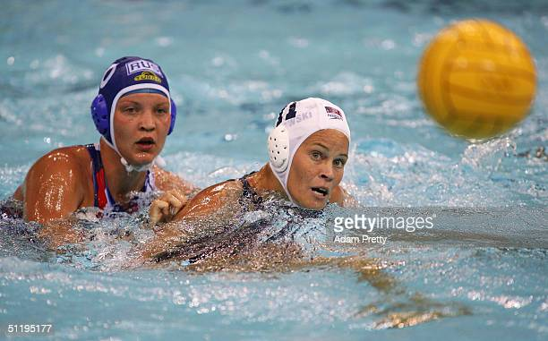 Amber Stachowski of USA in action against Olga Turova of Russia in the women's Water Polo preliminary game between USA and Russia on August 20 2004...