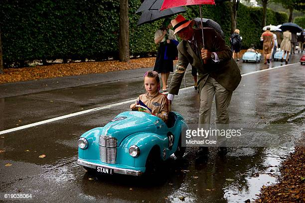 Amber Stanley on her way back to the paddock in her Austin J40 pedal car in the wet having competed in the Settrington Cup race at Goodwood on...