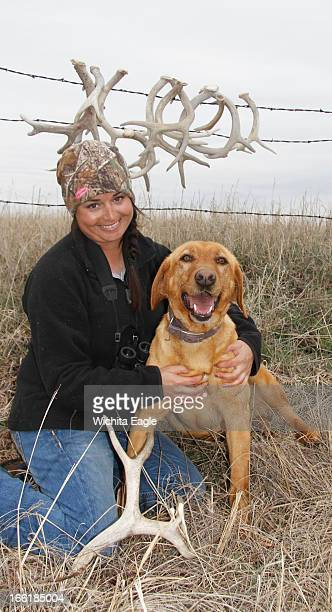 Amber Stimatze and Winnie with some of the antlers they found April 2 in Edwards County Kansas The dog is trained to find the antlers by sight and...