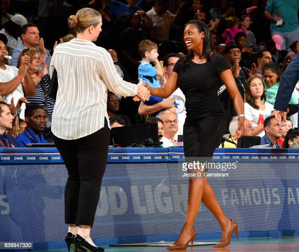 Amber Stocks of the Chicago Sky shakes hands with Katie Smith of the New York Liberty after the game in a WNBA game on August 27 2017 at Madison...