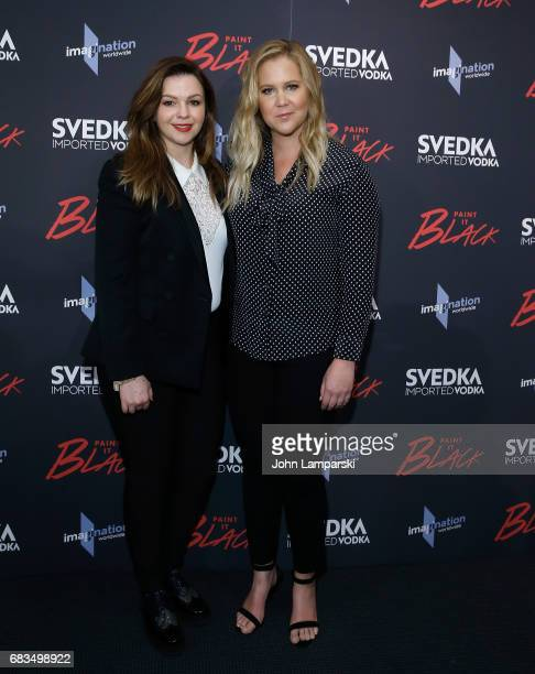 Amber Tamblyn and Amy Schumer attends 'Paint It Black' New York premiere at the Museum of Modern Art on May 15 2017 in New York City