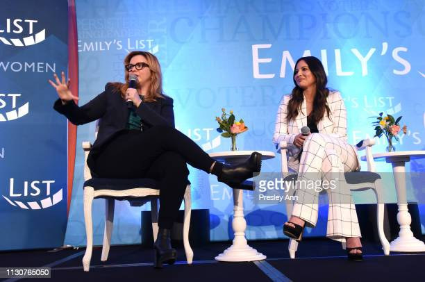 Amber Tamblyn and Olivia Munn speak onstage during Raising Our Voices Supporting More Women in Hollywood Politics at Four Seasons Hotel Los Angeles...