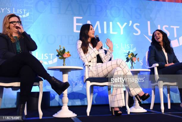 Amber Tamblyn Olivia Munn and Melissa Fumero speak onstage during Raising Our Voices Supporting More Women in Hollywood Politics at Four Seasons...