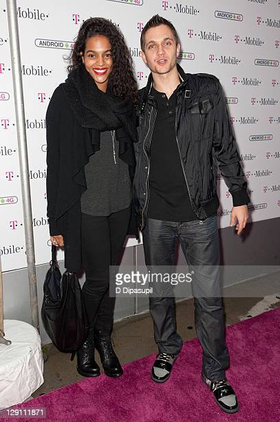 Amber Tolliver and guest attend the TMobile Samsung Galaxy S II and HTC Amaze 4G launch at Espace on October 12 2011 in New York City