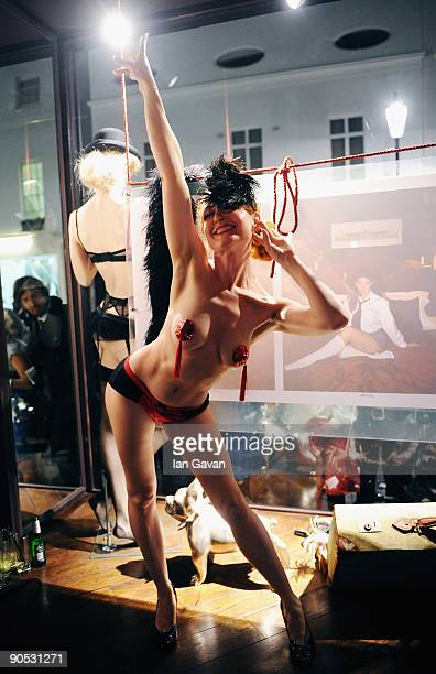 Amber Topaz performs at the private view of Coco De Mer And John Stoddart Love And Lust at the Coco De Mer Store on September 9 2009 in London England