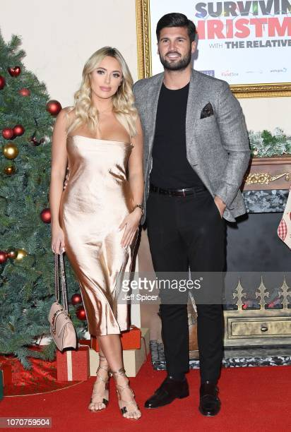 Amber Turner and Dan Edgar attends the 'Surviving Christmas With The Relatives' world premiere at the Vue West End on November 21 2018 in London...