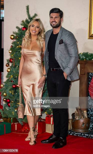 Amber Turner and Dan Edgar attends the World Premiere of 'Surviving Christmas With The Relatives' at Vue West End