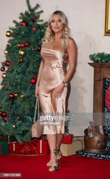 Amber Turner attends the World Premiere of 'Surviving Christmas With The Relatives' at Vue West End